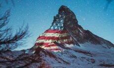 Bandeiras do mundo são projetadas em montanha da Suíça